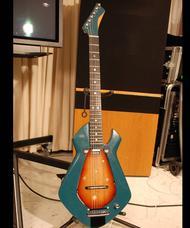 MIT guitar combines acoustics and electronics