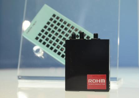 A Rohm fuel cell cartridge sits in front of an Aquafairy portable hydrogen fuel cell prototype at Ceatec 2013 in Japan on October 2, 2013.