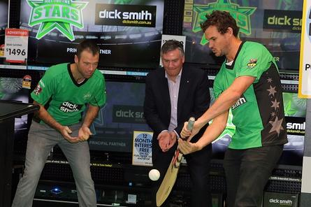 Rob Quiney and Clint McKay (right) from the Melbourne Stars have a round of instore cricket with Eddie Maguire.