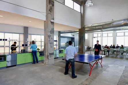 Employees play ping pong at Atlassian's office in San Francisco. Credit: Atlassian