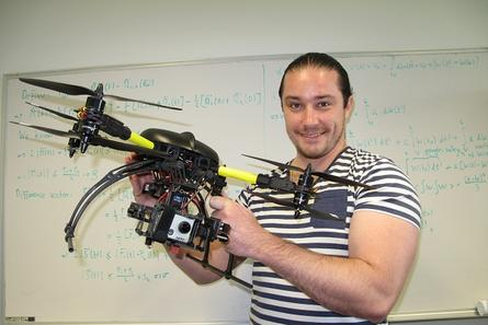 Monash University Wireless Sensors and Robot Networks lab co-director Doctor Jan Carlo Barca holding a quadcopter. Photo supplied by Monash University.