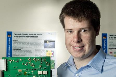 University of New South Wales engineering graduate Thomas Cooney with his prize winning radar circuit board.