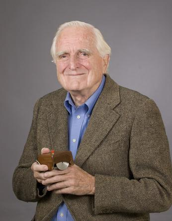 Douglas Engelbart and the computer mouse he invented.