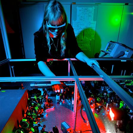 Researcher Helen Chrzanowski operates an experiment at The Australian National University that unlocks quantum discord in pairs of laser beams.
