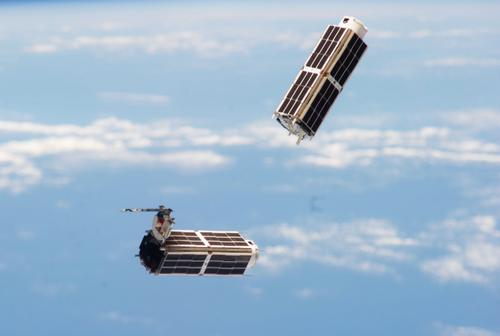 Two of Planet Labs imaging satellites are seen shortly after they were released from the International Space Station