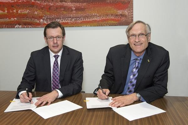 Cisco Australia and New Zealand vice president Ken Boal (left) signs the academy agreement with Flinders University Vice-Chancellor Professor Michael Barber. Photo supplied.