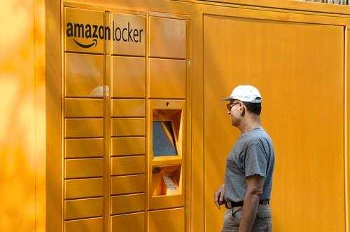 A passerby checks out Amazon's giant locker