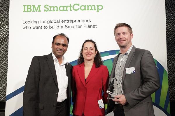 IBM's A/NZ ecosystem development leader Prasad Murcherla and A/NZ software group vice president Omeed Kroll congratulate 9 Spokes CMO Brendan Roberts. Image credit: IBM.