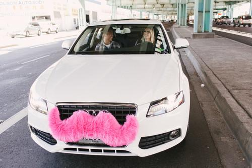 A Lyft car sporting its standard pink mustache.