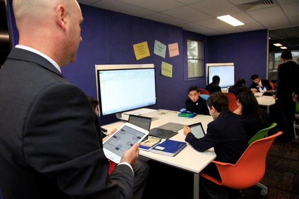 Delany College Year 7 and 8 students try out their connected classroom. Photo credit: Telstra.