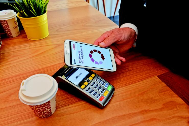 Samsung Galaxy and other phones with NFC can pay by tapping against existing POS terminals. The eftpos trial also includes payments via QR codes and Bluetooth. Credit: eftpos
