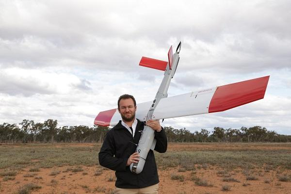 Ninox Robotics managing director Marcus Ehrlich holds one of the drones.