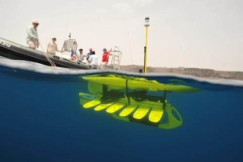 A Wave Glider SV2 seafaring robot is seen just before deployment.