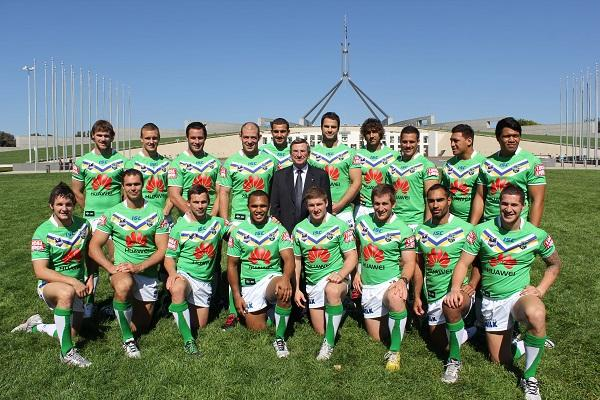 The Canberra Raiders line up with Huawei Australia chairman, John Lord, outside Parliament House in Canberra.