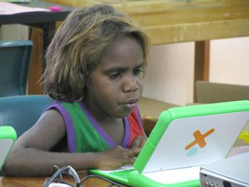 Student with XO laptop. Photo credit: OLPC Australia